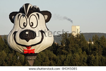 SUSSEX, CANADA - SEPTEMBER 8: Pepe the Skunk hot air balloon lands near PotashCorp in Penobsquis at the Atlantic International Balloon Fiesta on September 8, 2011 in Sussex, Canada.