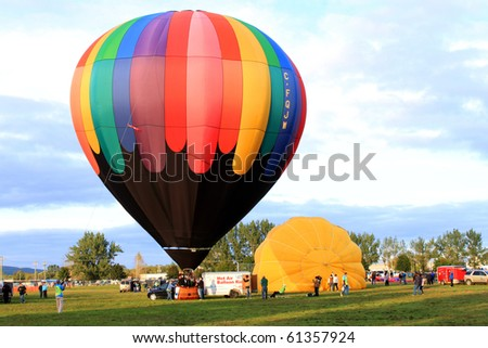 SUSSEX, NEW BRUNSWICK, CANADA - SEPT 12: Colorful hot air balloon are being inflated and getting ready for flight at Atlantic Balloon Festival in Sussex, NB, Canada on Sept. 12, 2010