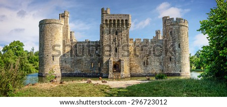 Sussex, United Kingdom - July 9, 2013: Moated castle Bodiam near Robertsbridge in East Sussex, England  was built in 1385 to defend the area against French invasion during the Hundred Years' War. - stock photo