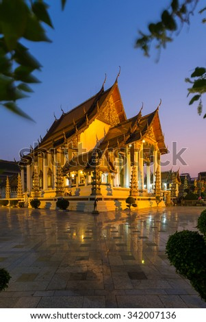 Suthat temple , the famous place of Buddha temple during twilight time , Bangkok , Thailand
