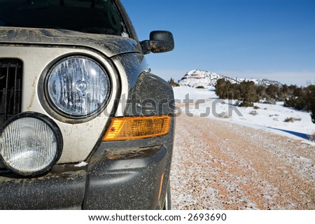 SUV kind of dirty - closeup after a day of fun in the mountains of wyoming - stock photo