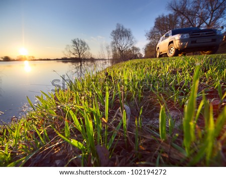 SUV on a roadside Hight water at Oka river in Russia - stock photo