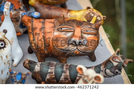 SUZDAL, RUSSIA - JULY 16, 2016: Feast of cucumber in Suzdal, handmade clay cats