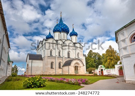 SUZDAL, RUSSIA - SEPTEMBER 08, 2014: Architectural and Museum Complex of the Suzdalian Kremlin. Cathedral of the Nativity of the Virgin. Built in the years 1222-1225  - stock photo