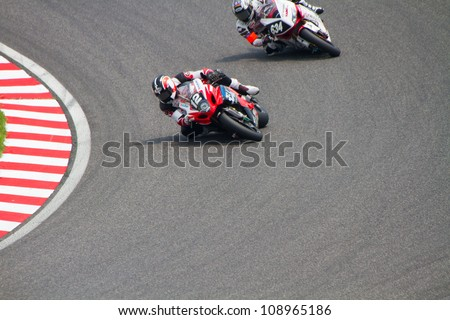 SUZUKA, JAPAN - JULY 29 : Rider of YOSHIMURA SUZUKI Racing Team (Not Classified) racing at 2012 Suzuka 8 hours World Endurance Championship Race, on July 29, 2012 in Suzuka Circuit, Japan.