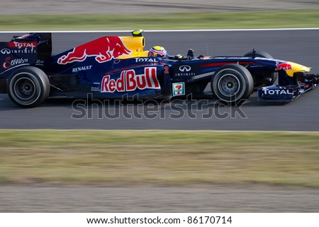 SUZUKA, JAPAN - OCTOBER 7 : Mark Webber of Red Bull Racing during free practice at 2011 Formula 1 Japanese Grand Prix on October 7, 2011 in Suzuka, Japan. - stock photo