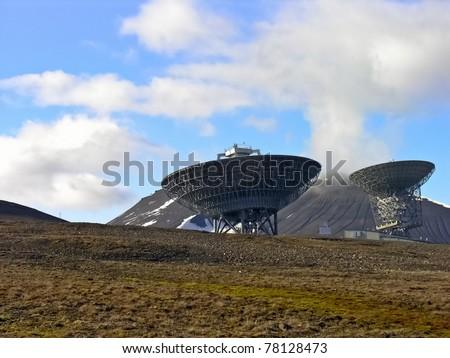 Svalbard parabola antenna installation into the wild - stock photo