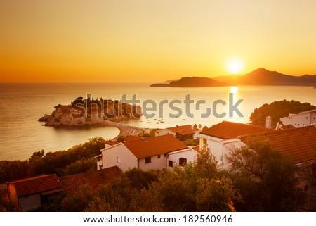 Sveti Stefan Island at Sunset in Montenegro. Balkans, Adriatic Sea. European Summer Resort. Copy Space. Toned Photo. - stock photo