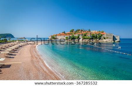 Sveti Stefan luxury touristic resort with historical village on the island and paradise Adriatic sea sand beach. Budva, Montenegro. - stock photo