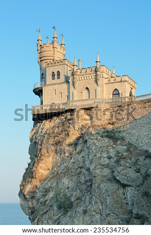 Swallow's Nest is a decorative castle the monument of architecture and history, the main attraction on the shores of the Black sea of the city Yalta, republic of Crimea, Russia - stock photo