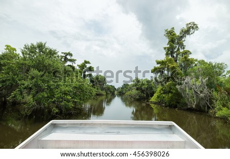 Swamp tour from Airboat in New Orleans, Louisiana, surrounded by lush green and wild swamp lands.  - stock photo
