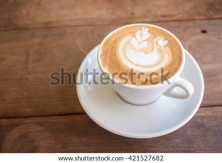 Swan latte art coffee on top wood table - stock photo