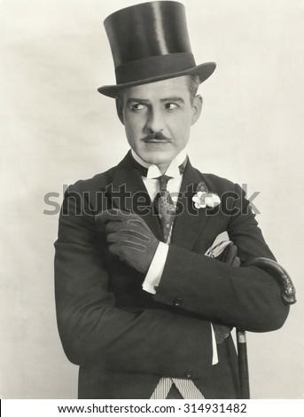 Swanky gentleman in top hat - stock photo