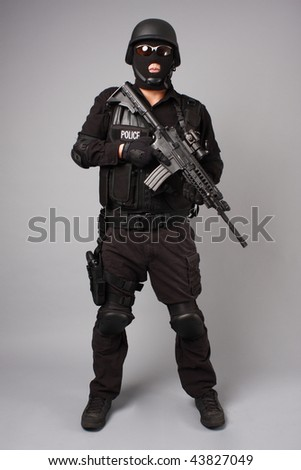 SWAT police officer with assault gun. - stock photo
