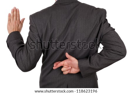 Swearing an oath with fingers crossed behind back concept for dishonesty or business fraud - stock photo