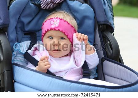 sweat girl in blue pram - stock photo