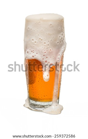 Sweated Craft Pub Beer Glass Overflowing with Beer #3 - stock photo