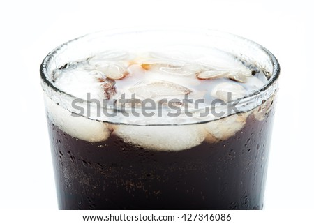 sweating cold glass with ice and soda close up - stock photo