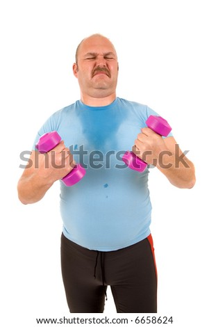 Sweating overweight man trying to work with hand weights - stock photo