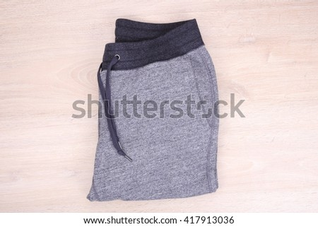 Sweatpants on wooden background