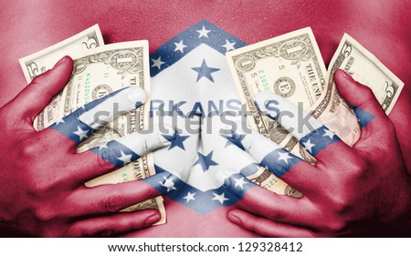 Sweaty girl covered her breast with money (dollars), flag of Arkansas