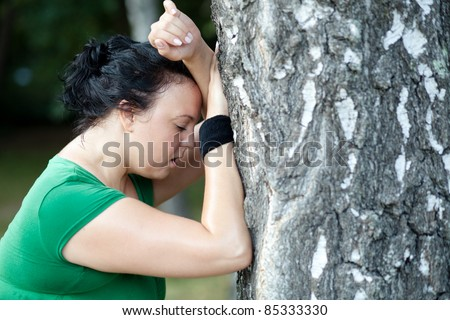 Sweaty overweight woman catching her breath after a long run. Shallow DOF. - stock photo