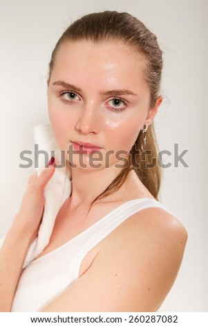 sweaty young woman with towel after fitness exercising - stock photo
