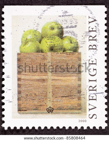 SWEDEN - CIRCA 2000:  A stamp printed in Sweden showing a peck of Granny Smith apples in a wooden box.  Painting by Philip Von Schantz, circa 2000. - stock photo