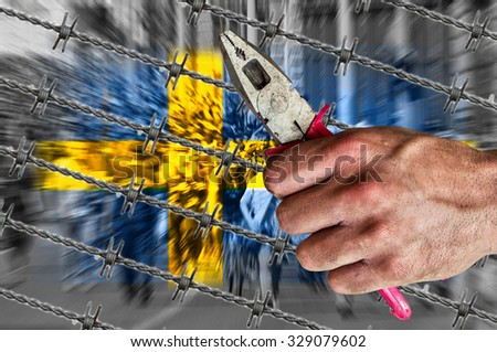 Sweden flag, migrants, and barb wire with pliers