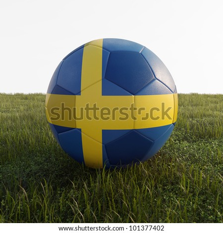 sweden soccer ball isolated on grass - stock photo