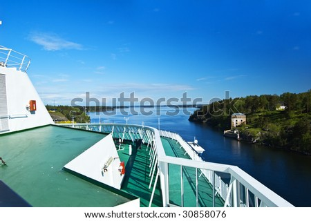 Swedish archipelago with a cruise ship detail - stock photo