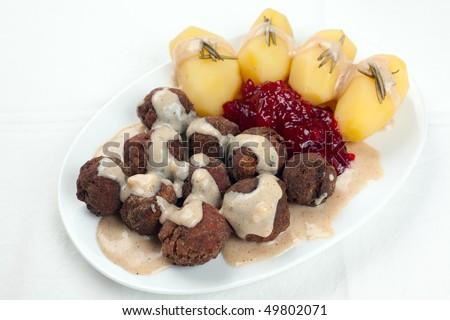 Swedish Kottbullar meatball with brunsas sauce, boiled potatoes and lingon jam - stock photo