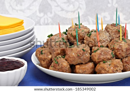 Swedish meatballs served as an appetizer with a side of jelly for dipping. - stock photo