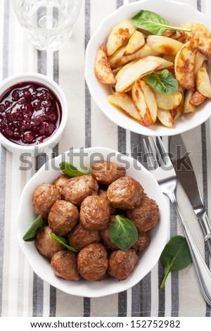 swedish meatballs with potatoes and lingon jam  - stock photo