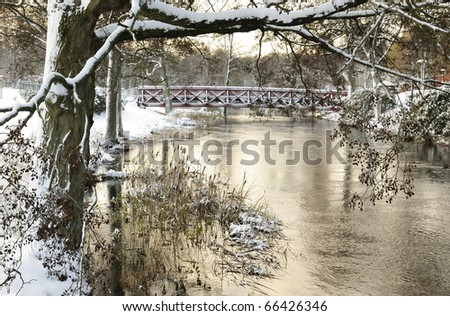 Swedish park river in winter season - stock photo