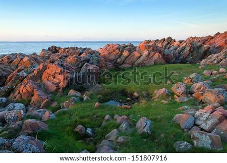Swedish rocky coast at the sunset - stock photo
