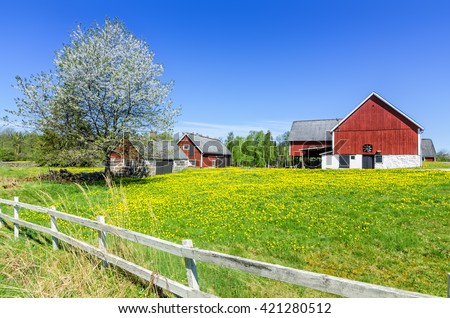 Swedish spring farm with traditional fence - stock photo