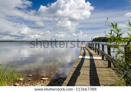 Swedish wooden bridge on the lake