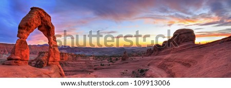 Sweeping sunset panoramic view of famous Delicate Arch in Arches National Park in Moab, Utah (HDR) - stock photo