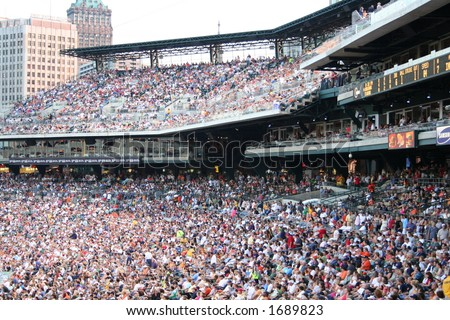 Sweeping view of the massive crowd at a Tigers baseball game. - stock photo