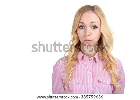 sweet and beautiful girl offended by something standing on white isolated background