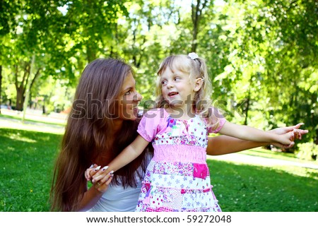 sweet and beautiful girl with her mom