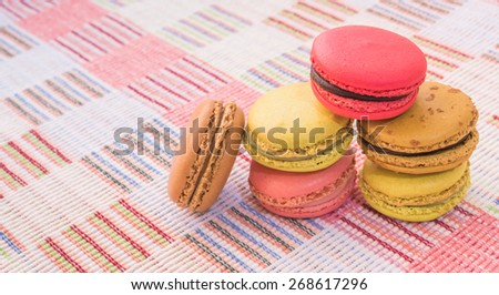 Sweet and colorful french macaroons on cotton cloth background . - stock photo