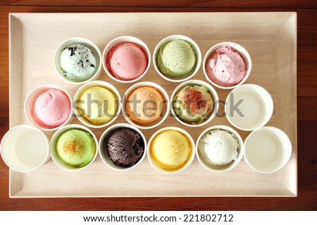 sweet and colorful ice cream scoops on wooden plate - stock photo