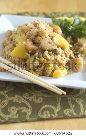 Sweet and Savory Shrimp and Fruit Fried Rice with Chopsticks - stock photo