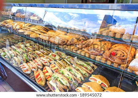 Sweet and savory take away street food display at Plaza de la Reina in Valencia, Spain - stock photo