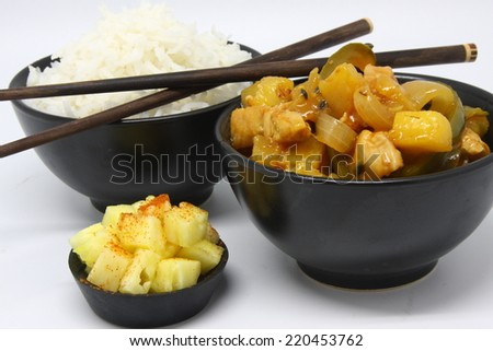 Sweet and sour chicken  with rice and pineapple dish meal tasty chop stick asian food chicken delicious savory - stock photo