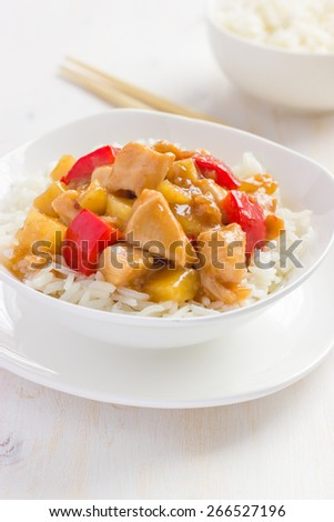 Sweet and sour chicken with rice in white bowl - stock photo