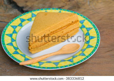 Sweet and tasty Coffee flavoured cake in dish and wooden spoon.  great for during coffee break - top view