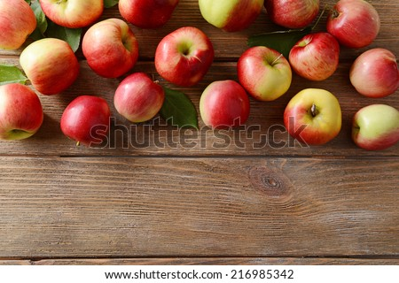 Sweet apples on wooden background - stock photo